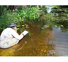 Snake Artist vs Alligator Photographic Print