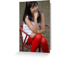 little girl sit down in park Greeting Card