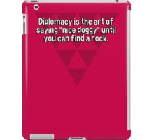 "Diplomacy is the art of saying ""nice doggy"" until you can find a rock. iPad Case/Skin"