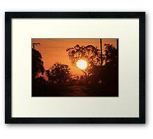 holding the sun up Framed Print