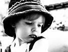 Little Girl Wearing A Hat by Evita
