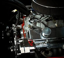 A beautiful sight of chrome. metal, and rubber ..Chevy engine (photo) by jammingene
