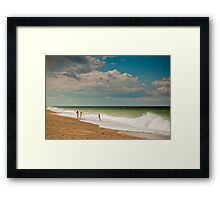 Fun in the sea at Cley Framed Print