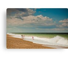 Fun in the sea at Cley Canvas Print