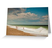 Fun in the sea at Cley Greeting Card