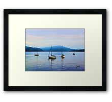 Boats resting on the water in Scotland Framed Print