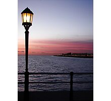 The Sun Goes Down And The Lamps Come On Photographic Print