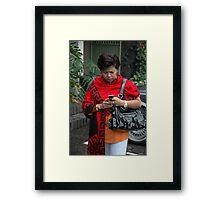 holding mobile phone Framed Print