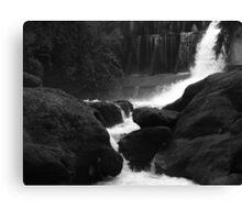 water rushing past rocks Canvas Print