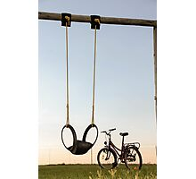 A lonely duet... Empty swing and lonely bicycle waiting for kids to play... Photographic Print