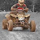 Quad biker on track by NKSharp