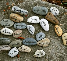 Peace messages on pebbles by Catherine Ames