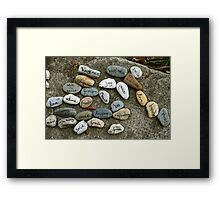 Peace messages on pebbles Framed Print