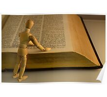 Small Wooden Manikin Using A Dictionary - Poster