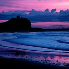 Indigo Dawn - Nobbys Breakwall and Lighthouse by Sandy Sutton