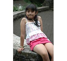little girl sit down in park Photographic Print
