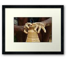 The hands of the potter. Framed Print