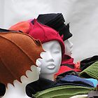 Mannheim - Felt hats in a Christmas market by Maureen Keogh