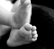 Feet of a newborn baby by ManwithaCamera