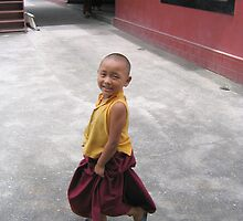 dancing by. young tibetan monk - india by tim buckley | bodhiimages