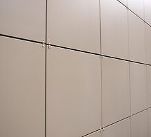 Beige wall of the large decorative tiles by vladromensky