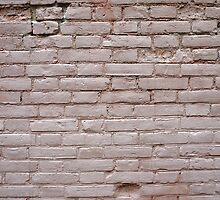 Detail of a wall of the old beige clay bricks by vladromensky