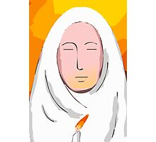 nun praying in candle light. Photographic Print