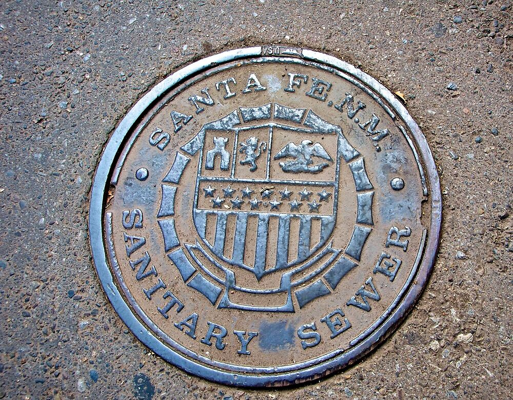 Santa Fe, NM, sewer cover by Ann Reece