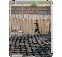 Block charcoal and banh da are bring dried under the sun iPad Case/Skin
