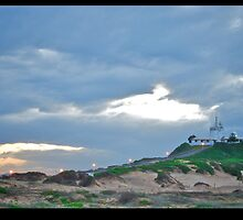 Nobbys Beach - Morning lighthouse by ejbimage