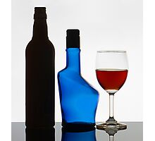 Wine Glass and The Empty Bottles. Photographic Print