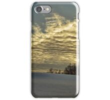 Evening clouds over the snow covered field iPhone Case/Skin