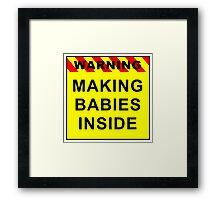 Warning - Making babies inside Framed Print