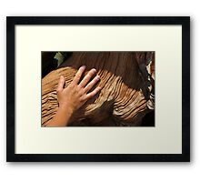 Weathered hand on an old wood stump Framed Print
