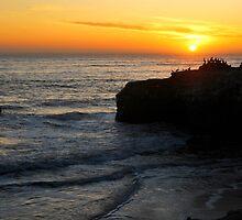Sunset over bird rock - Santa Cruz California  by Nyal Bennett