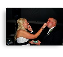 Bride and Groom Eating Cake Canvas Print