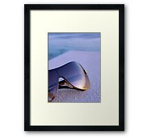 Bronze Tinted Sunglasses Reflecting Sunset on Waterfront Framed Print