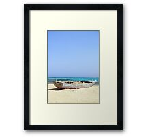 Shipwrecked Wooden Boat on Sandy Beach with Aqua Sky Background Framed Print
