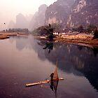 fishing before the rain by greg angus