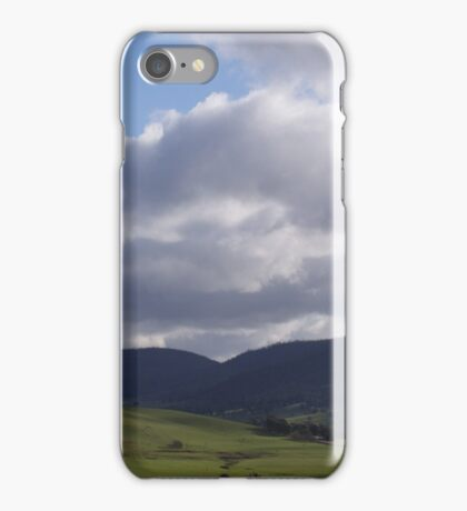 Green valley, grey mountains, white clouds iPhone Case/Skin