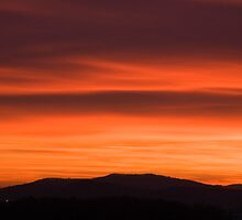Sunset over Ljubljana suburb by Ian Middleton