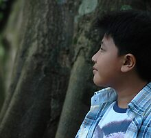 young boy looking to the top by bayu harsa