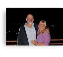 the happy couple on the roof top bar of thier motel in Poros Canvas Print