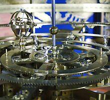 Golden metal cogwheels inside clockwork by Atanas Bozhikov Nasko