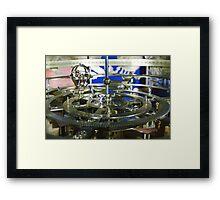 Golden metal cogwheels inside clockwork Framed Print