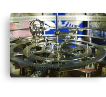 Golden metal cogwheels inside clockwork Canvas Print
