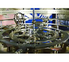 Golden metal cogwheels inside clockwork Photographic Print