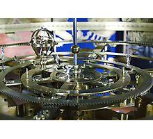 Golden metal cogwheels inside clockwork Photographic Print