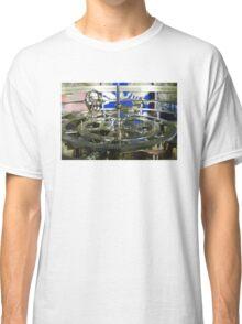 Golden metal cogwheels inside clockwork Classic T-Shirt