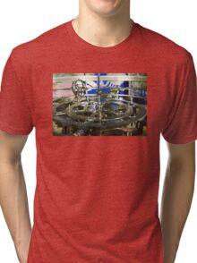 Golden metal cogwheels inside clockwork Tri-blend T-Shirt